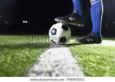Foot on soccer ball - stock photo