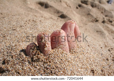 foot on the sand, summer theme - stock photo