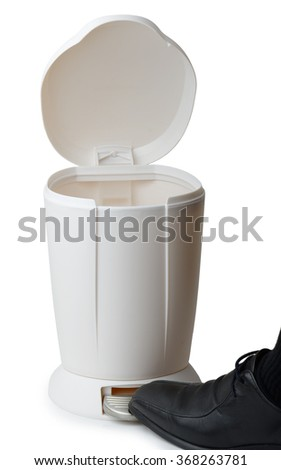 foot opening a pedal bin isolated on a white background - stock photo