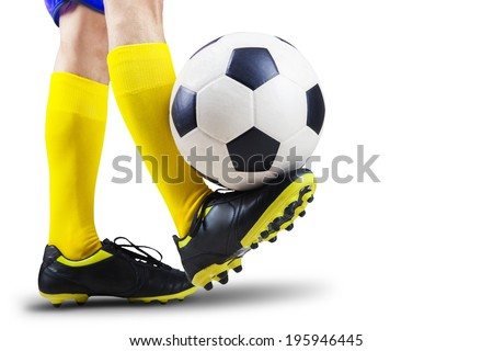 Foot playing soccer ball isolated on white background - stock photo