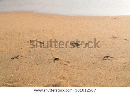 Foot print of father and child on the beach background