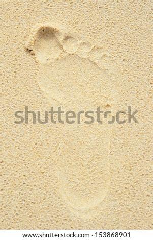 Foot print on the beach - stock photo