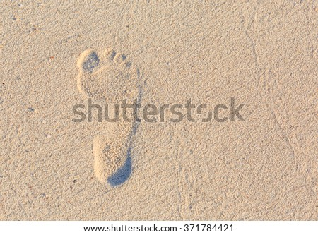 foot print on the beach background