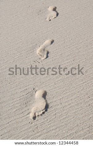 Foot prints in the sand - stock photo