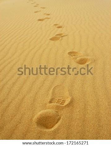 Foot prints on sand - stock photo