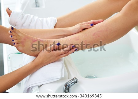 foot scrub pedicure woman leg in nail salon on chair sofa - stock photo