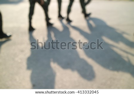 Foot soldiers walk blurred - stock photo