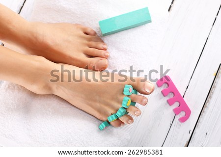 Foot spa. Foot care treatment and nail, the woman at the beautician for pedicure. - stock photo
