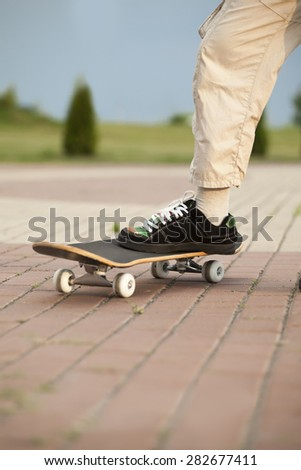 foot stand on skateboard outdoors