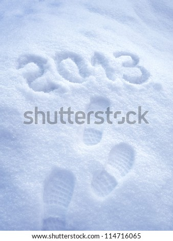 Foot step print in snow,?? New Year 2013 concept - stock photo