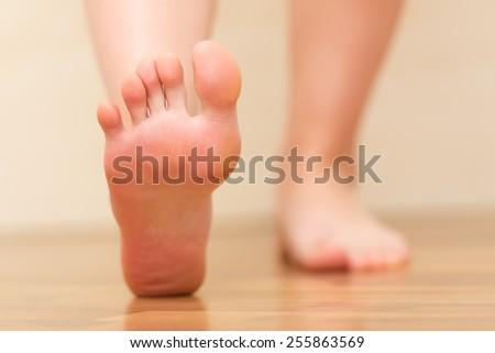 Foot stepping closeup - stock photo