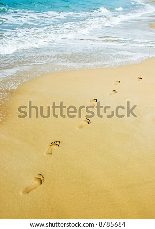 foot steps on the beach in the tropics - stock photo