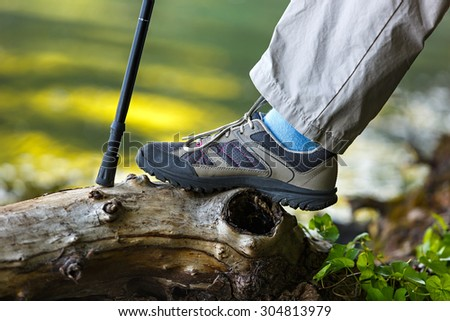 Foot tourist in hiking boots. - stock photo