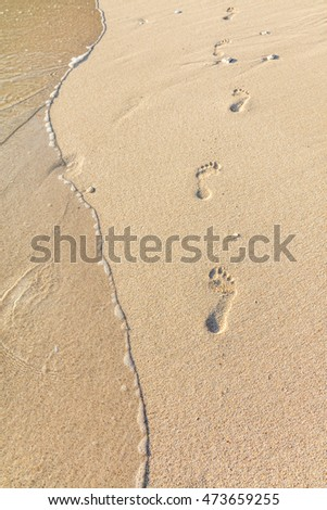 Foot tracks on sand, Diniwid Beach, Boracay Island, Philippines