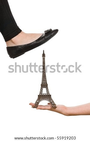 Foot trying to crush Eiffel Tower - stock photo