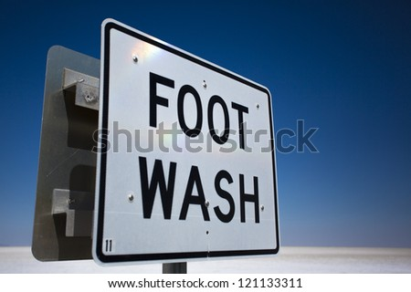 Foot Wash sign at Bonneville Salt Lake Flats against a blue sky - stock photo