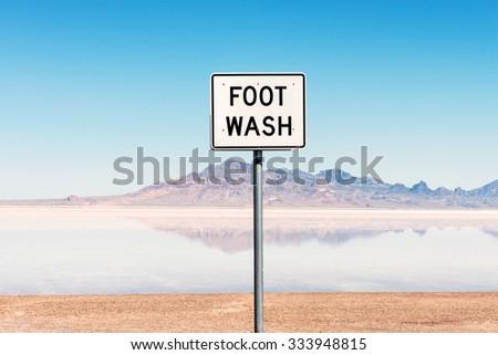 Foot wash sign, Bonneville Salt Flats, Utah USA - stock photo