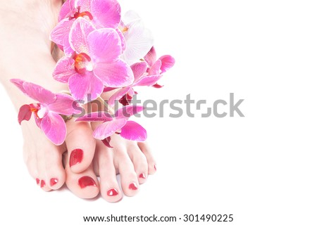 foot with pedicure, fingers covered with red lacquer with orchids isolated white
