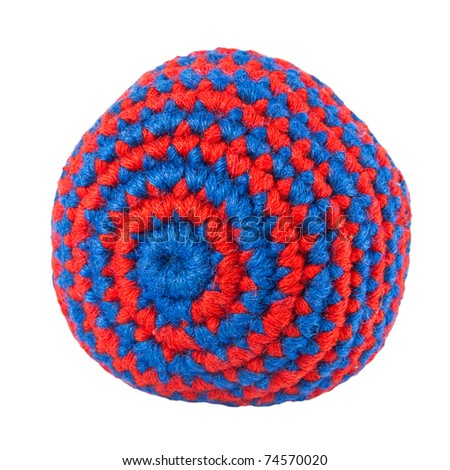 Footbag - closeup of popular teenagers' game: knitted red and blue soft ball, isolated on white background - stock photo