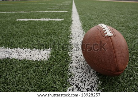 Football along the hashmarks - stock photo