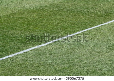 Football and soccer field grass - stock photo