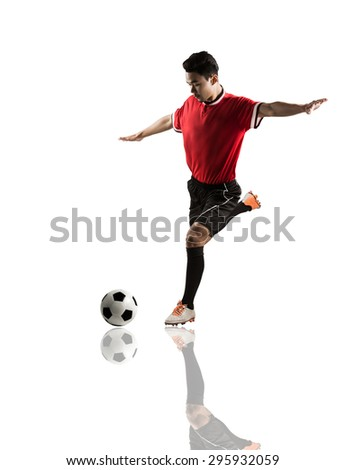 Football Asia Is about to kick the ball with force - stock photo