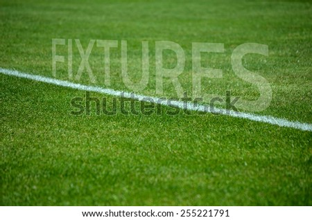 Football background Text fixtures on green grass with white lane - stock photo