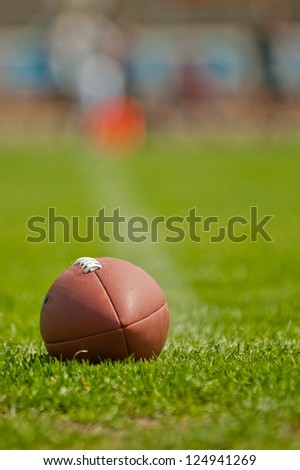 Football ball at stadium green grass