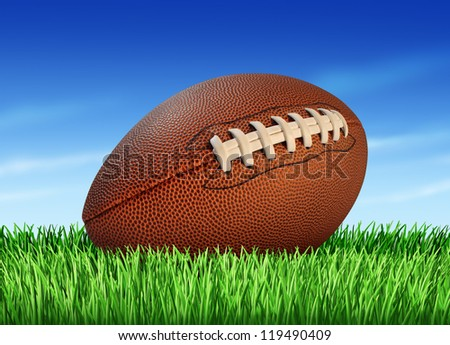 Football ball on a grass field and a blue sky as a professional or college game sport for traditional American and Canadian play.