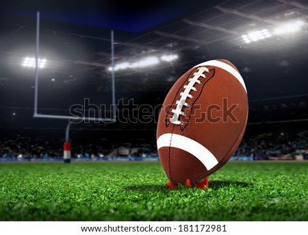 Football Ball On Grass in a Stadium - stock photo