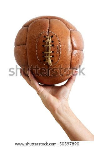Football ball vintage retro brown leather in man hand