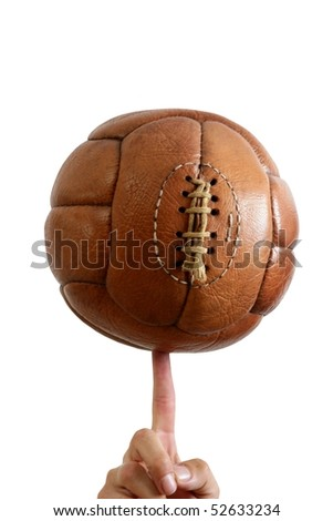 Football ball vintage retro brown leather in man hand - stock photo