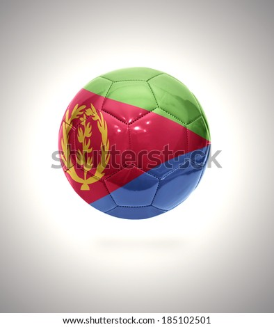 Football ball with the national flag of Eritrea on a gray background - stock photo