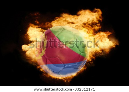 football ball with the national flag of eritrea on fire on a black background - stock photo