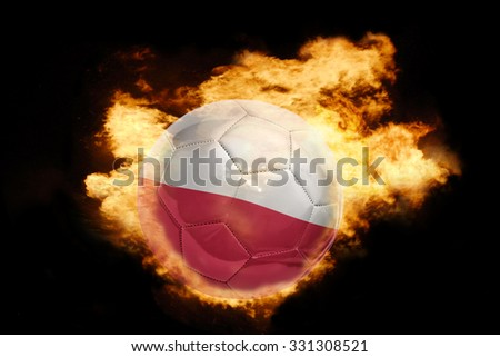 football ball with the national flag of poland on fire on a black background - stock photo