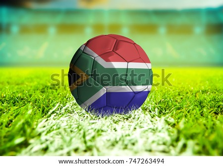 football ball with the national flag of South Africa ball with Green grass background