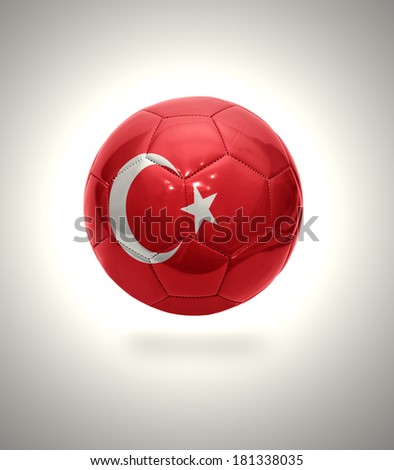 Football ball with the national flag of Turkey on a gray background - stock photo