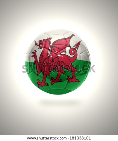 Football ball with the national flag of Wales on a gray background
