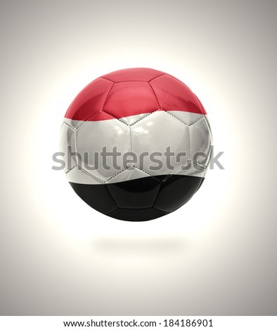 Football ball with the national flag of Yemen on a gray background