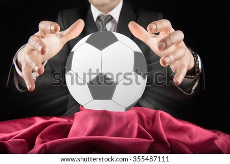 Football betting estimator looks at the crystal ball - stock photo