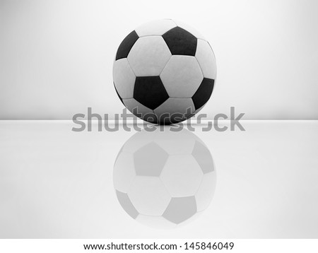 Football black and white on glossy surface - stock photo