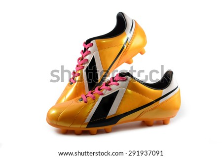 Football boots gold on white background  - stock photo