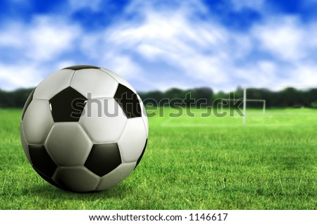 football by a football pitch - stock photo