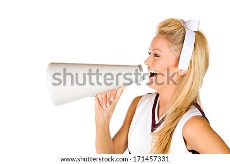 Football: Cheerleader Yelling Through Megaphone - stock photo