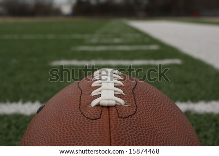 Football close up with room for copy and yardlines carrying off - stock photo