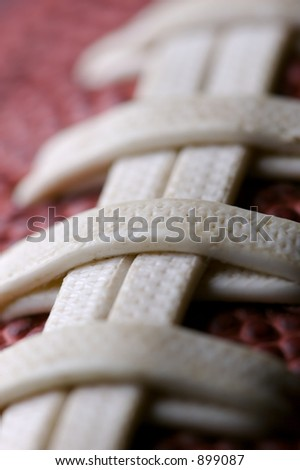 football close up  with shallow depth of field and focus on second seam - stock photo