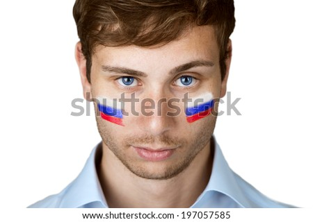 football fan with russian flag painted at the face  - stock photo