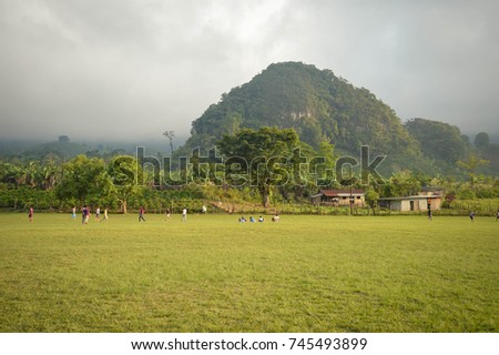 Football field and the foggy mountainous landscapes of Santa Barbara National Park in Honduras. Football is very popular in Honduras and every small village has a few fields in full size