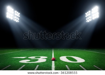 Football field at night - stock photo