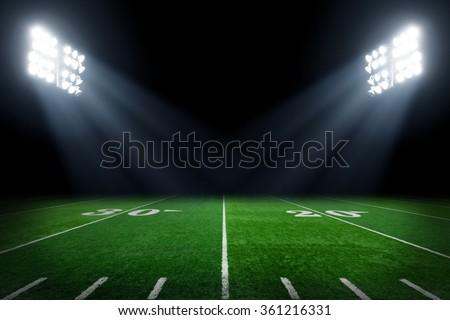 Football field at night - stock photo